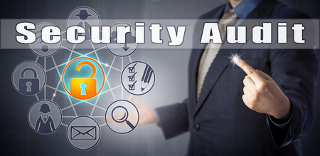 Male corporate consultant in blue shirt and suit is initiating a Security Audit. Corporate and computer security procedures metaphor and information technology concept for a technical assessment. Stock Photo