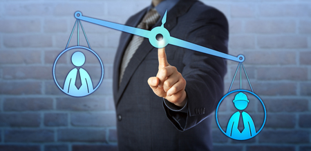 Male blue collar worker icon is outweighing a white collar employee symbol on a virtual pair of balances. Business concept for mediation, pay gap, performance review and workplace discrimination. Banque d'images