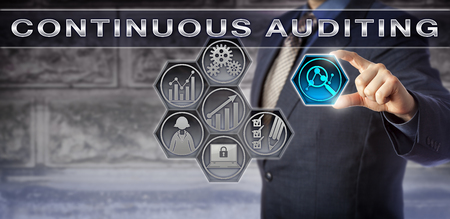 assessments: Blue chip business executive activating an automated Continuous Auditing process via a virtual touch screen interface. Business concept for internal audit and automatic control and risk assessments. Stock Photo