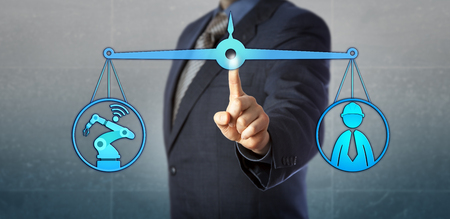 Blue chip manufacturing manager is balancing out machine automation versus human labor. Concept for reshaping of human work through cyber manufacturing, Industry 4.0 and cyber physical systems. Stock Photo