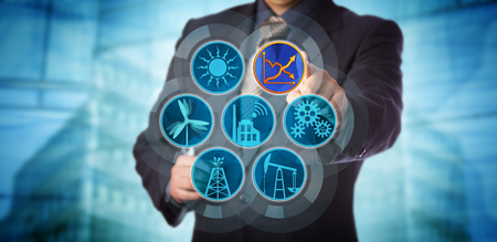 Blue chip manager monitoring energy efficiency via a virtual control interface. Industry concept for efficient energy use, sustainability reporting, audit and rise in renewable power generation. Banque d'images