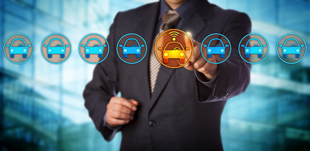 Blue chip automobile designer selecting a connected auto in a lineup. Concept for autonomous or driverless car, vehicle tracking system, artificial intelligence and vehicular communication systems. Stock Photo
