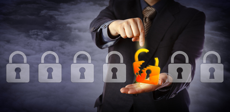 Blue chip cyber security manager is pointing out a broken virtual padlock in a lineup of otherwise intact locks. Information technology concept for data security breach, cyber risk and hacker attack. Banco de Imagens - 81630956