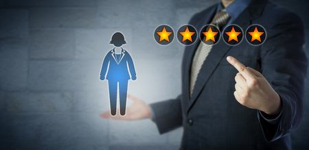 five star: Blue chip manager is pointing at the five star rating of a female white collar worker. Human resource management metaphor for promotion,  performance appraisal, career development and motivation. Stock Photo
