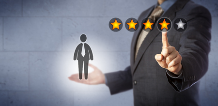 Blue chip human resources manager is giving a male employee a four star rating out of five. Business concept for performance review and monitoring, talent management, career development discussion.