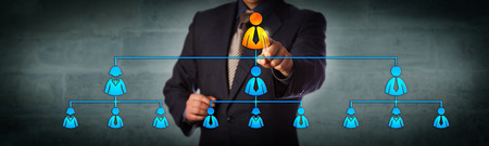 Blue chip chairman is selecting the top executive in a hierarchical organizational chart. Business concept for multi level marketing network, recruitment, leadership and corporate hierarchy. Archivio Fotografico