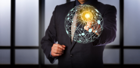 Blue chip business manager is touching a secured access point in a virtual global mesh network. Information technology concept for cloud computing, computer network connections and world wide web.
