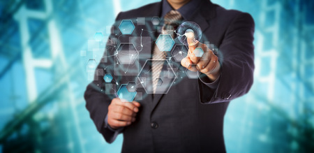 Blue chip businessman activating artificial neural network interface. Computer science concept for machine learning, pattern recognition, artificial intelligence, data driven modeling and analytics. Stock Photo