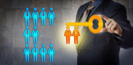 Unrecognizable HR manager is unlocking the potential of a work team with a virtual key with workers for key bit. Concept for team building, talent management, success, solution and achievement.