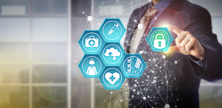 Faceless businessman plugging virtual padlock into health care IT interface. Technology concept for healthcare data exchange and health information management via computerized systems and networks.