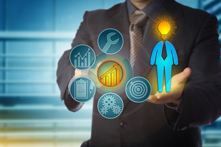 Faceless business coach is right on target with the career development of a bright employee. Human resources concept for talent management, performance review and continued professional development. Stock Photo