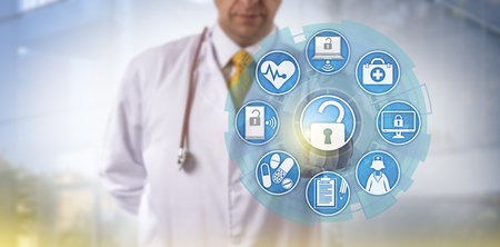 Unrecognizable doctor of medicine is accessing online healthcare data via a touch screen interface. Cyber security and IT concept for health information exchange or HIE within the medical sector. Stock Photo