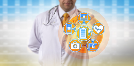 Unrecognizable doctor synchronizing patient medical records across portable devices. Healthcare concept for health information technology, electronic medical records, practice management system.