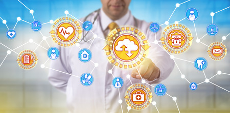 Unrecognizable male doctor of medicine is synchronizing data via a software as a service application interface. Healthcare IT concept for medical practice management and health information exchange.