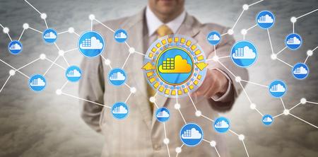 Unrecognizable male enterprise IT client utilizing cloud container infrastructure. Computer software and information technology concept for application container technology and containerization. Archivio Fotografico