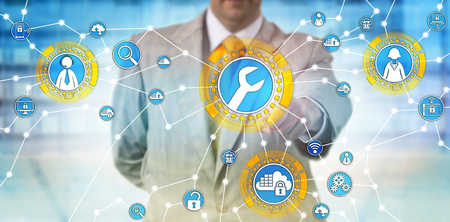 Unrecognizable male corporate manager is activating managed services via touch screen interface. Enterprise computing concept for outsourced IT management, technical support and cloud computing. Standard-Bild