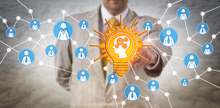 Unrecognizable recruiter touching a learning mind in lightbulb. Concept for artificial intelligence, machine learning, personal development, talent acquisition, knowledge transfer and inspiration.