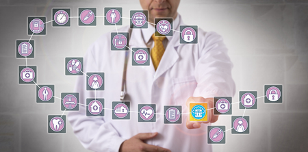 Unrecognizable male physician is highlighting a data block record in a healthcare blockchain. 写真素材