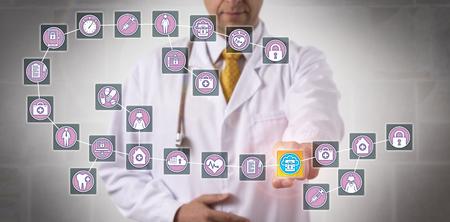 Unrecognizable male physician is highlighting a data block record in a healthcare blockchain. Archivio Fotografico