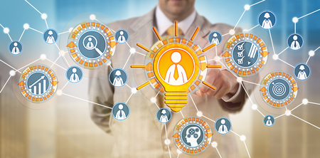 Unrecognizable recruiter is highlighting a bright male candidate in a professional network. Recruitment concept for talent acquisition, performance review, promotion, career and personal development.