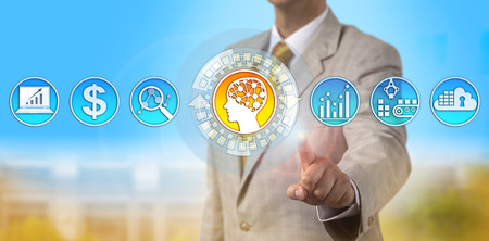 Unrecognizable logistics manager activating an AI application. Technology concept for self-learning system, artificial intelligence, price prediction, machine learning, supply and demand estimate. Stock Photo