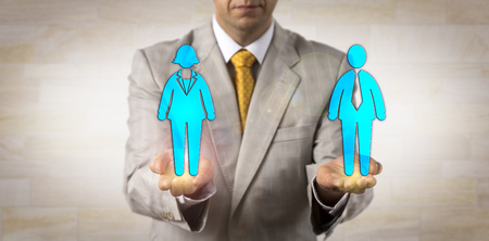 Unrecognizable recruiter balancing out one male worker on a par with one female in the open palms of his hands. Human resources concept, equal opportunity, gender equality, diversity, emancipation.