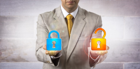 Unrecognizable IT manager presenting one locked and one open virtual padlock in his hands. Concept for access control, data security, vulnerability, double lock concept, two factor authentication.