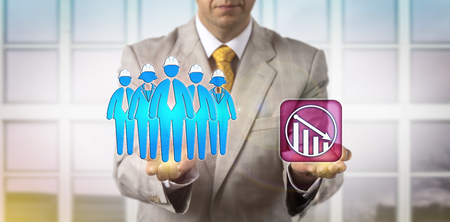 Unrecognizable HR manager is equating a team of five blue collar workers with a downward trend icon. HRM concept for demotion, team failure, moving down, wages, decrease in skilled manual labor. Stock Photo