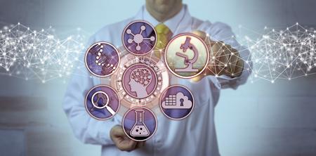 Ein nicht erkennbarer männlicher Wissenschaftler schließt eine Mikroskopie-App an eine Schnittstelle für Gehirnstudien an. Wissenschaftliches Konzept für Biowissenschaften, Molekulartechnik, Bioingenieurwesen, Pharmakogenomik, Pharmakogenetik. Standard-Bild
