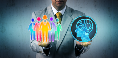 Unrecognizable employer confronting a multicultural work team with an artificial intelligence system. Business concept for AI adoption, machines supplementing or replacing the human workforce.