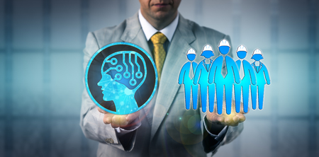 Unrecognizable male corporate manager pairing artificial intelligence with a blue collar work team. Human resources management and technology concept for machine and deep learning, labor regulations. Фото со стока