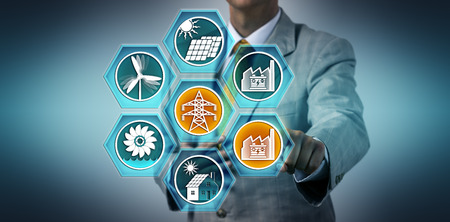 Utility manager feeding the electricity of a battery storage power station into the renewable energy grid. Industry concept for BESS, ESS, grid stabilization and reliability, electric feed-in.