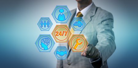 Unrecognizable male business manager is activating 24/7 service buttons on a virtual touch screen. Information technology and business concept for managed services, help desk, remote assistance.
