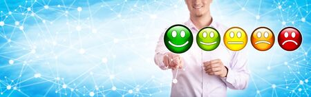 Young smiling business man in casual shirt gives excellent rating in cyberspace. Technology and business concept for customer satisfaction, online review, consumerism. Web banner with copy space.