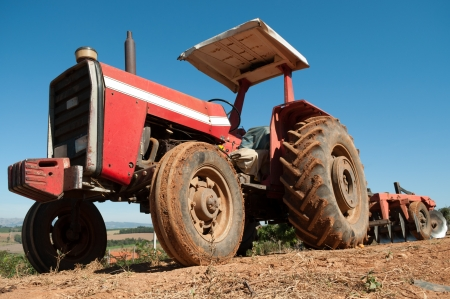 Vintage Tractor with plowshare in a farm Stock Photo - 14378541