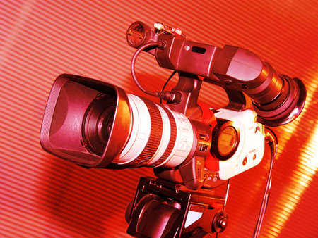 television camera: Television camera in studio detail toned in red color Stock Photo