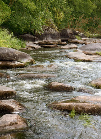 the rapids: River rapids with stone in water