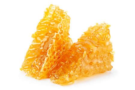 Yellow Honeycomb slice closeup isolated on white