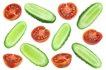 Cucumber and brown cherry tomatoes set on white Stockfoto