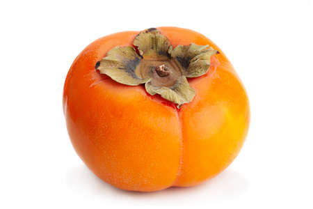 Persimmon fruit closeup isolated on white