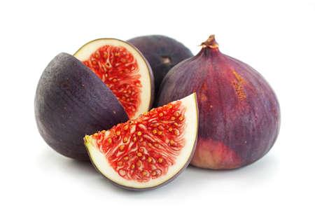 Purple fig fruit closeup isolated on white background