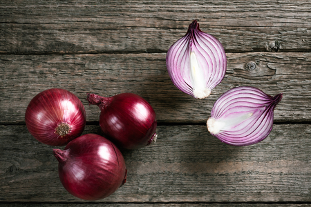 red onions: Fresh organic red onions on a wooden background