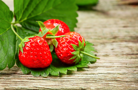 Strawberry. Fresh strawberry. Red strewberry. Loosely laid strawberries in different positions. Stock Photo