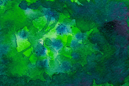 Green watercolor background on embossed paper with blue dots . Abstract watercolor pattern.