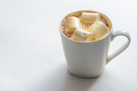 Cup Of Coffee with Marshmallows. White mug of hot drink with copy space background