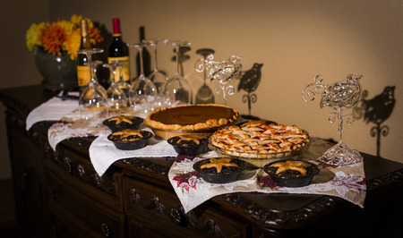 cary: A beautiful arrangement of Thanksgiving Holiday Pies including pumpkin, cherry and minced meat. Stock Photo