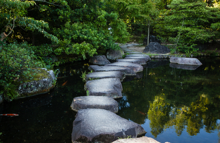 garden pond: Step stones path over a pond in Koko-en Garden near White Egret Castle, in Himeji, Hyogo Prefecture in Japan