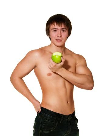 Apuesto joven muscular entrega de manzana verde Foto de archivo