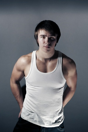 undershirt: Handsome young muscular man in white undershirt Stock Photo
