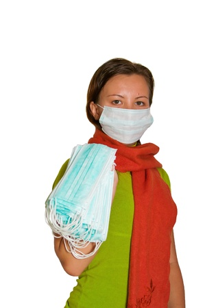 Young woman holding bunch of face masks. Isolated on white Stock Photo - 10588563
